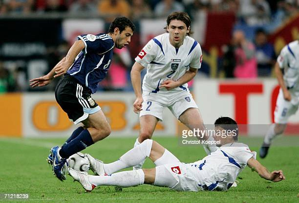 Javier Mascherano of Argentina is fouled by Mateja Kezman of Serbia Montenegro and is later sent off during the FIFA World Cup Germany 2006 Group C...