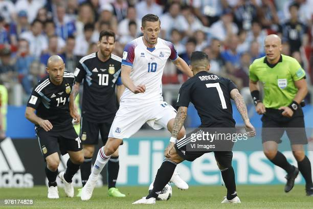 Javier Mascherano of Argentina Lionel Messi of Argentina Gylfi Por Sigurdsson of Iceland Ever Banega of Argentina referee Szymon Marciniak during the...