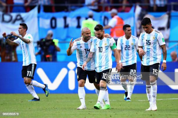 Javier Mascherano of Argentina talks with teammate Lionel Messi during the 2018 FIFA World Cup Russia Round of 16 match between France and Argentina...