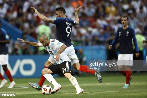 Javier Mascherano of Argentina vies Olivier Giroud of France team during the 2018 FIFA World Cup Russia Round of 16 match between France and...