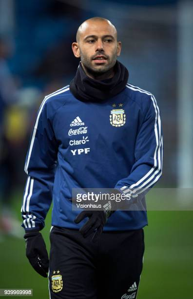 Javier Mascherano of Argentina warms up before the International Friendly match between Argentina and Italy at the Etihad Stadium on March 23 2018 in...