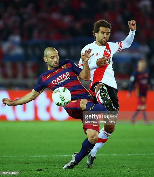 Javier Mascherano of Barcelona and Leonardo Ponzio of River Plate challenge for the ball during the FIFA Club World Cup Final match between River...