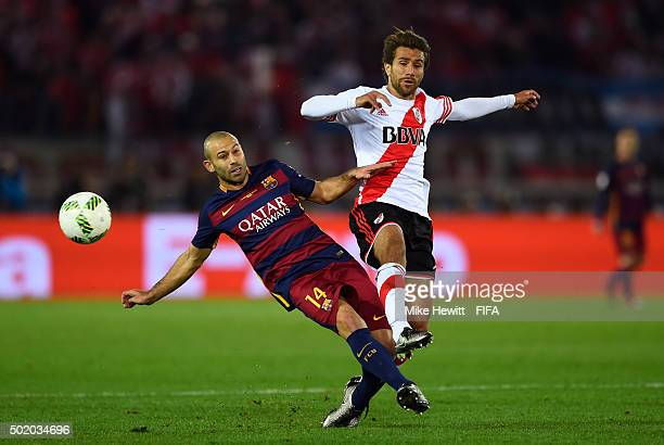Javier Mascherano of Barcelona and Leonardo Ponzio of River Plate compete for the ball during the FIFA Club World Cup Final between River Plate and...