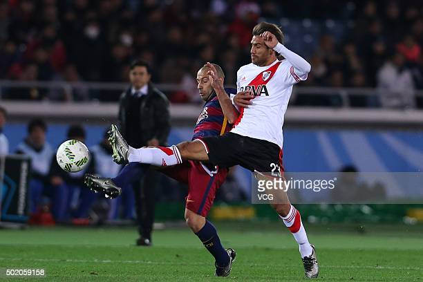Javier Mascherano of Barcelona and Leonardo Ponzio of River Plate compete for the ball during the FIFA Club World Cup Final Match between FC...