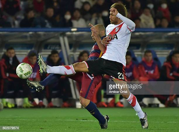 Javier Mascherano of Barcelona and Leonardo Ponzio of River Plate compete for the ball during the FIFA Club World Cup final match between River Plate...