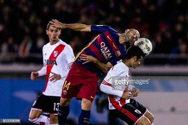 Javier Mascherano of Barcelona and Rodrigo Mora of River Plate compete for the ball during the FIFA Club World Cup Final Match between FC Barcelona...