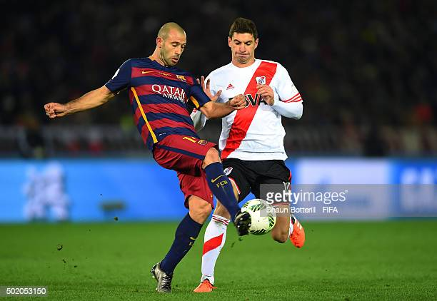 Javier Mascherano of Barcelona clears the ball as Lucas Alario of River Plate closes in during the FIFA Club World Cup Final between River Plate and...