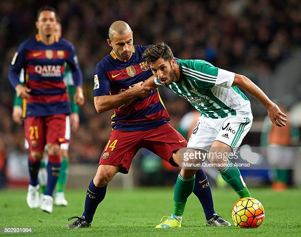 Javier Mascherano of Barcelona competes for the ball with CeJudo of Betis during the La Liga match between FC Barcelona and Real Betis Balompie at...