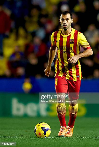 Javier Mascherano of Barcelona runs with the ball during the la Liga match between Levante UD and FC Barcelona at Ciutat de Valencia on January 19...
