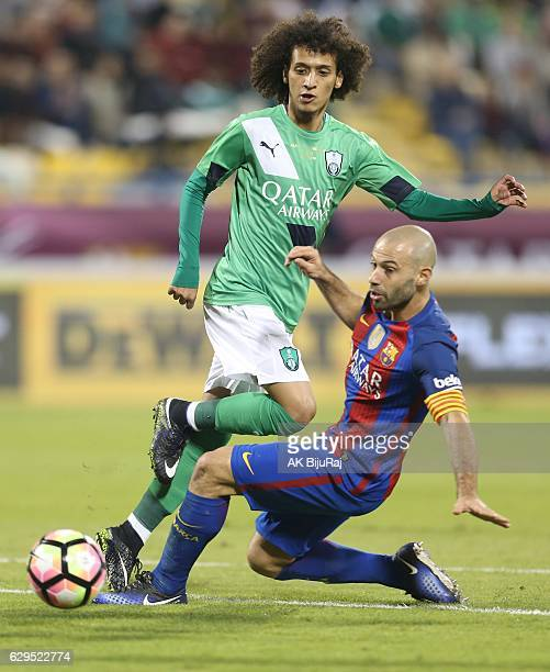 Javier Mascherano of Barcelona tackled by Omar Abdulrahman of Al-Ahli Saudi FC during the Qatar Airways Cup match between FC Barcelona and Al-Ahli...
