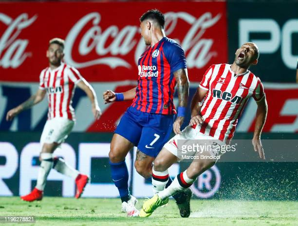 Javier Mascherano of Estudiantes is fouled by Adam Bareiro of San Lorenzo during a match between San Lorenzo and Estudiantes as part of Superliga...