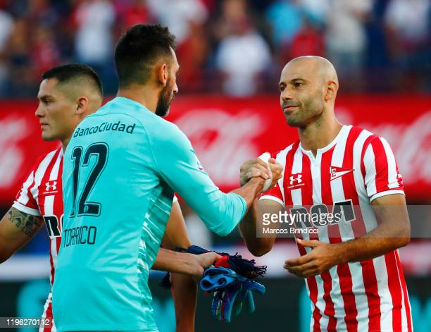 Javier Mascherano of Estudiantes shakes hands with Sebastian Torrico of San Lorenzo before a match between San Lorenzo and Estudiantes as part of...