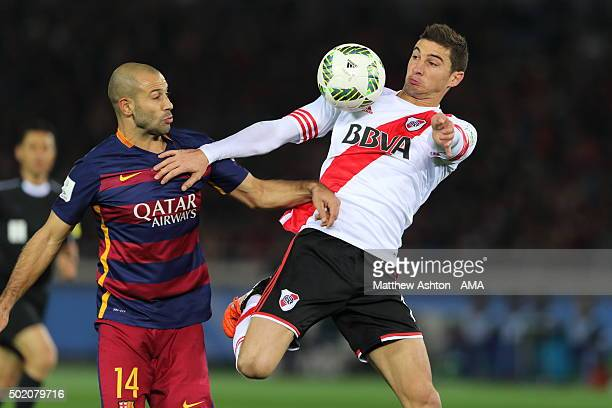 Javier Mascherano of FC Barcelona and Lucas Alario of River Plate during the FIFA Club World Cup Final Match between FC Barcelona and River Plate at...