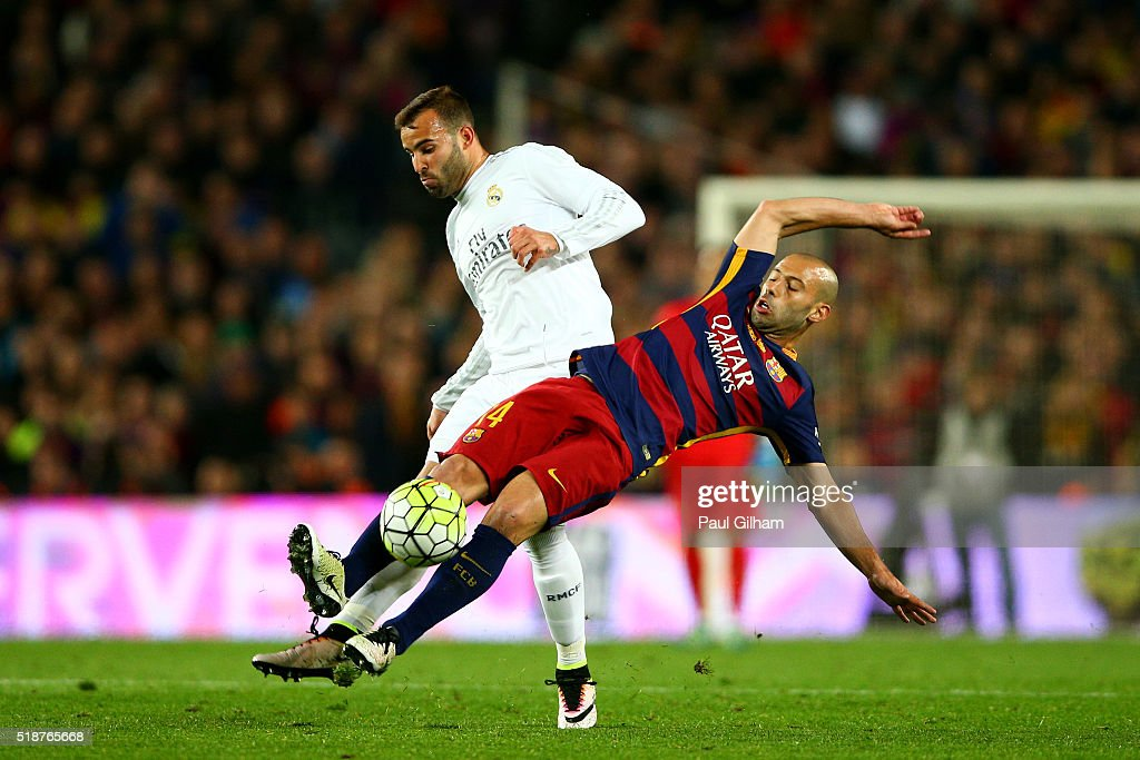 Javier Mascherano of FC Barcelona battles for the ball with Jese of Real Madrid CF during the La Liga match between FC Barcelona and Real Madrid CF at Camp Nou on April 2, 2016 in Barcelona, Spain.