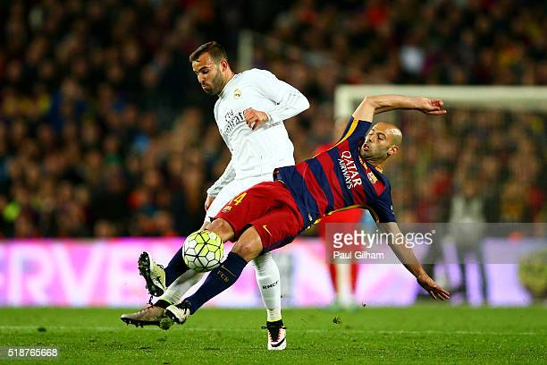 Javier Mascherano of FC Barcelona battles for the ball with Jese of Real Madrid CF during the La Liga match between FC Barcelona and Real Madrid CF...