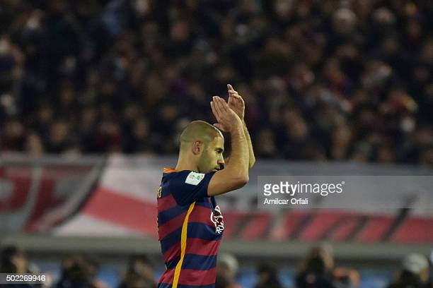 Javier Mascherano of FC Barcelona claps as he is substituted during the FIFA Club World Cup final match between River Plate and FC Barcelona at...