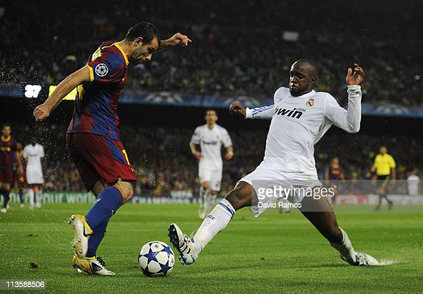 Javier Mascherano of FC Barcelona fights for the ball against Lass Diarra of Real Madrid during the UEFA Champions League Semi Final second leg match...