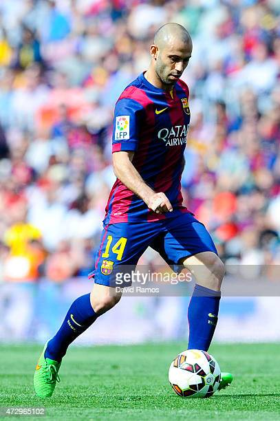 Javier Mascherano of FC Barcelona runs with the ball during the La Liga match between FC Barcelona and Valencia CF at Camp Nou on April 18 2015 in...