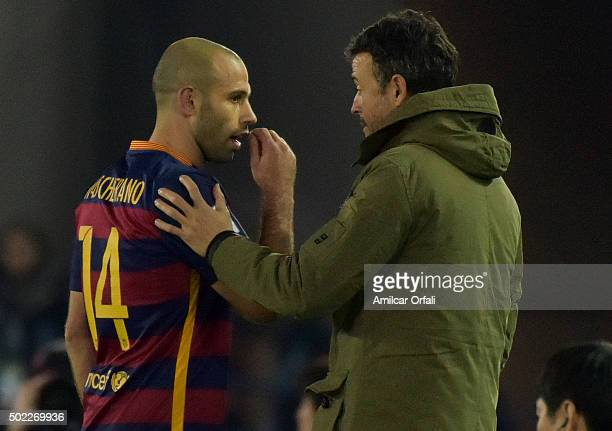 Javier Mascherano of FC Barcelona talks to Luis Enrique coach of FC Barcelona as he is substituted during the FIFA Club World Cup final match between...