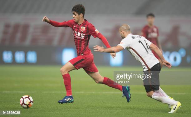 Javier Mascherano of Hebei China Fortune and Oscar of Shanghai SIPG in action during 2018 China Super League match between Shanghai SIPG and Hebei...