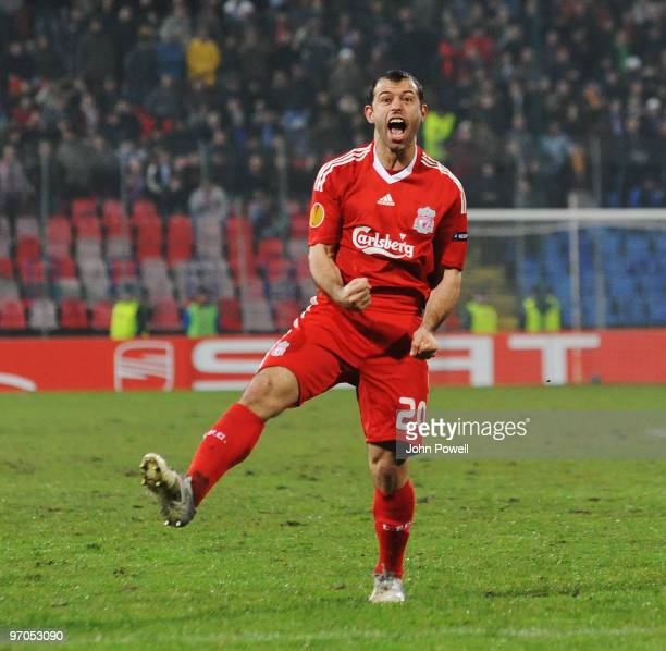 Javier Mascherano of Liverpool celebrates after scoring a goal during the UEFA Europa League knockout round second leg match between FC Unirea...
