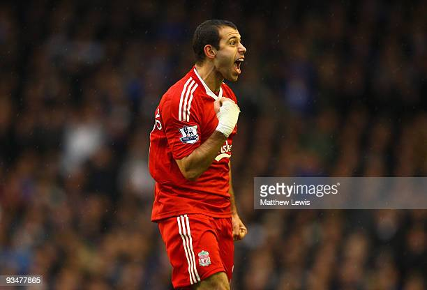 Javier Mascherano of Liverpool celebrates after the opening goal was scored via a deflection from Joseph Yobo of Everton during the Barclays Premier...