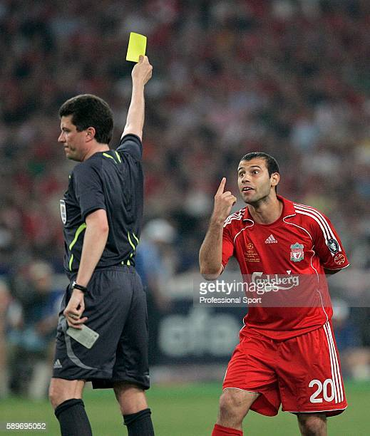 Javier Mascherano of Liverpool pleads his innocence after being booked by referee Herbert Fandel during the UEFA Champions League Final match between...