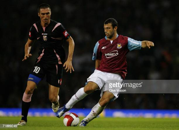 Javier Mascherano of West Ham is pursued by Andrea Caracciolo of Palermo during the UEFA Cup first round first leg match between West Ham United and...