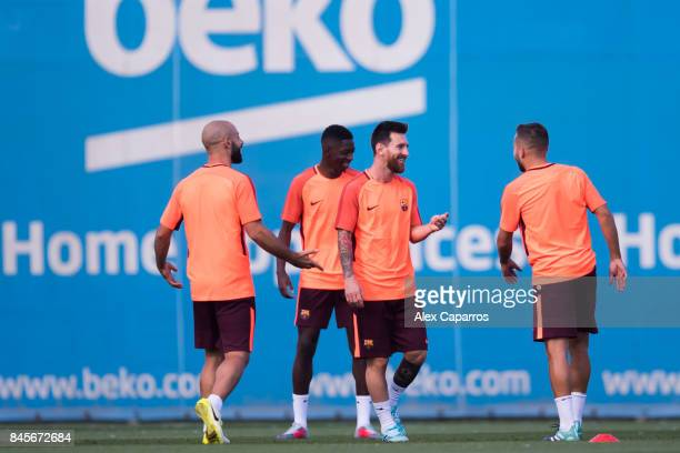 Javier Mascherano Ousmane Dembele Lionel Messi and Jordi Alba of FC Barcelona smiles during a training session ahead of the UEFA Champions League...