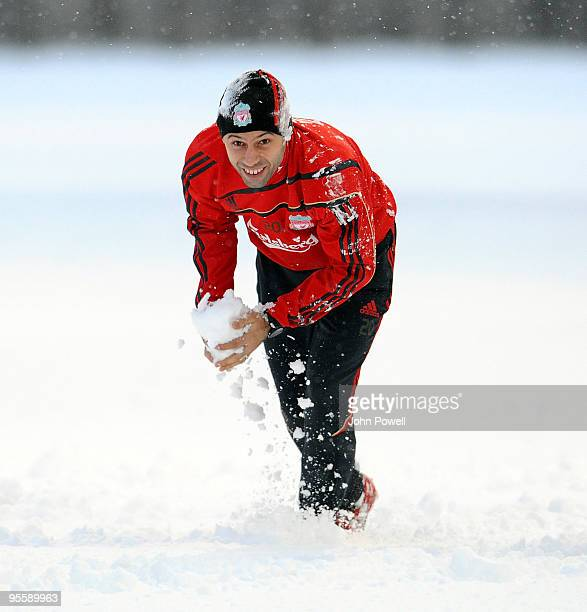 Javier Mascherano plays in the snow during a training session at Melwood Training Ground on January 5 2010 in Liverpool England