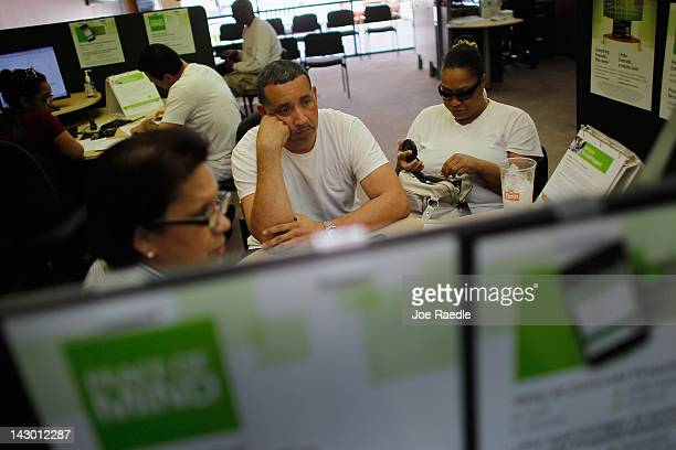 Javier Merlo and his wife Robin Merlo do their taxes at an HR Block office with the help of Moraiba Mata a tax professional on April 17 2012 in Miami...