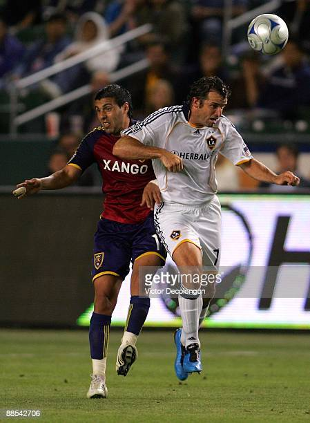 Javier Morales of Real Salt Lake and Chris Klein of the Los Angeles Galaxy vie for a ball during the MLS match at The Home Depot Center on June 13...