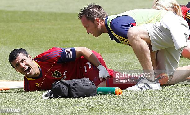 Javier Morales of Real Salt Lake screams in pain after he was taken down by Marcos Mondaini of Chivas USA during the first half of an MLS soccer game...