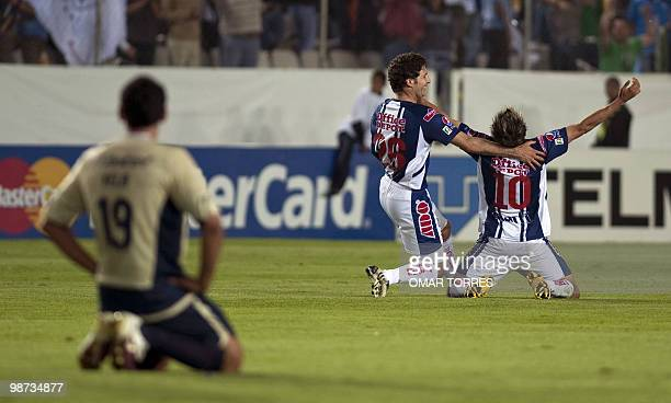 Javier Munoz and Edgar Benitez of Mexican Pachuca celebrate their victory in front of Alejandro Vela of Mexican Cruz Azul at the end of the CONCACAF...