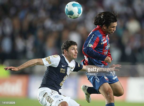 Javier Munoz of Pachuca and Francisco Fonseca of Atlante in action during a game as part of the Torneo de Clausura 2012 in a match between Pachuca...