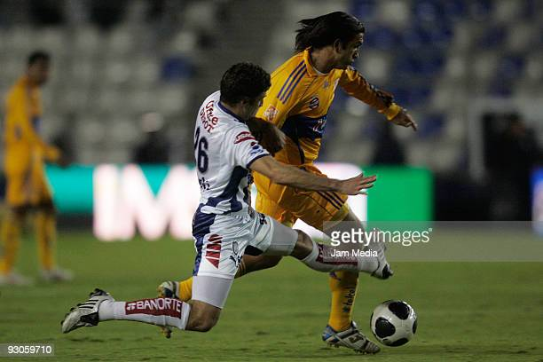 Javier Mustafa of Pachuca vies for the ball with Francisco Fonseca of Tigres during their match in the 2009 Opening tournament, at the Hidalgo...