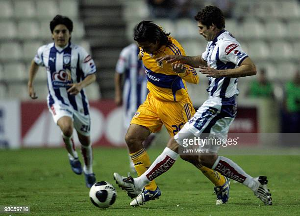Javier Mustafa of Pachuca vies for the ball with Francisco Fonseca of Tigres during their match in the 2009 Opening tournament at the Hidalgo Stadium...