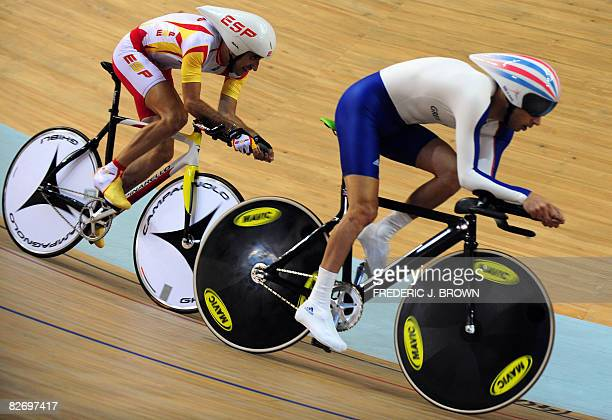 Javier Ochoa of Spain chases Darren Kenny of Great Britain while competing in the men's individual pursuit cycling track competition during the 2008...