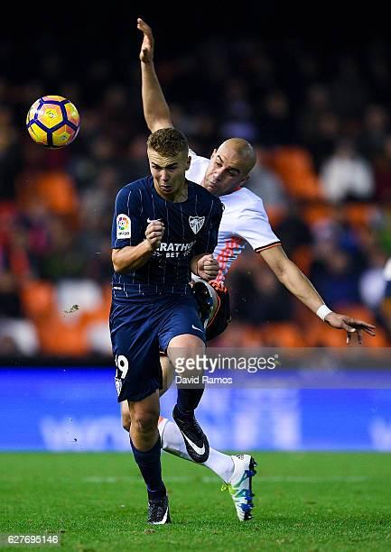 Javier Ontiveros of Malaga CF for the ball with Aymen Abdennour of Valencia CF during the La Liga match between Valencia CF and Malaga CF at Mestalla...