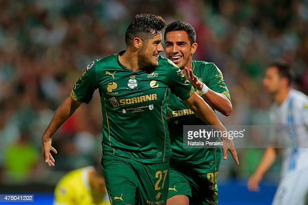Javier Orozco and Alonso Escoboza of Santos celebrate the third goal of their team during a championship first leg match between Santos Laguna and...