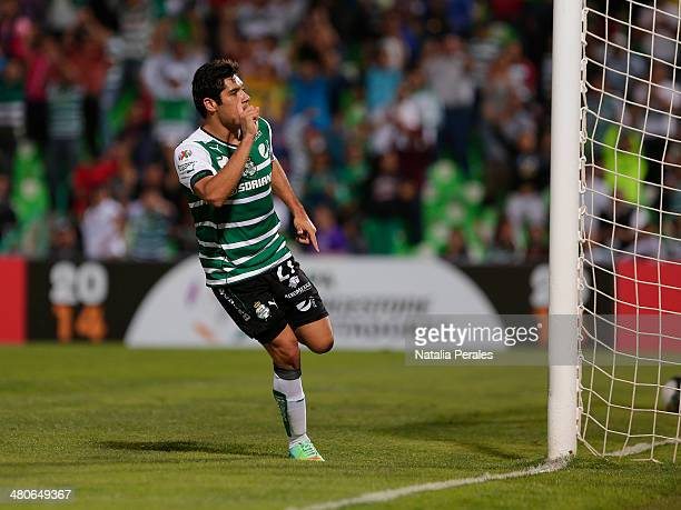 Javier Orozco celebrates after scoring his team's second goal during a match between Santos Laguna and Peñarol as part of the fifth round of Copa...