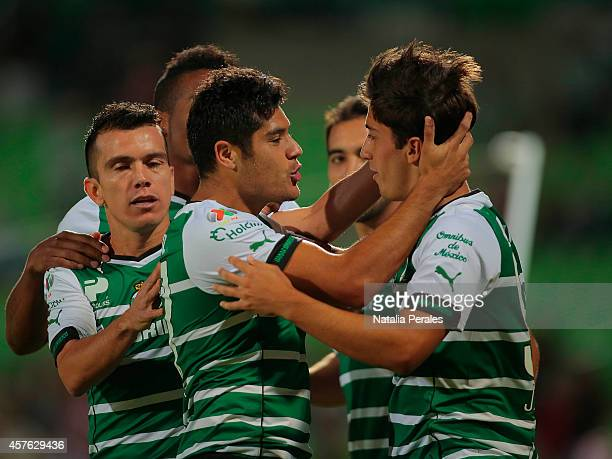 Javier Orozco celebrates with teammates after scoring his first goal of the game during a Quarterfinals match between Santos Laguna and Chivas as...