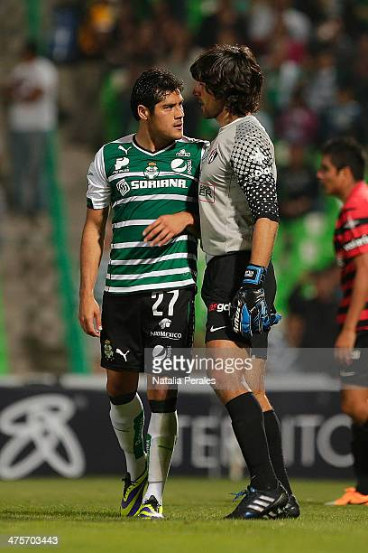 Javier Orozco of Santos and Federico Vilar faceoff each other during a match between Santos Laguna and Atlas as part of the Clausura 2014 Liga MX at...