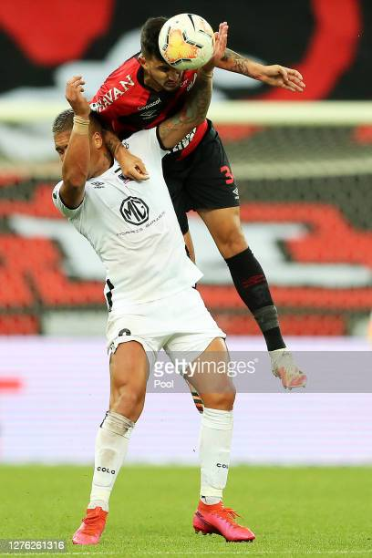 Javier Parraguez of ColoColo fights for the ball with Pedro Henrique of Athletico Paranaenseduring a group C match of Copa CONMEBOL Libertadores 2020...
