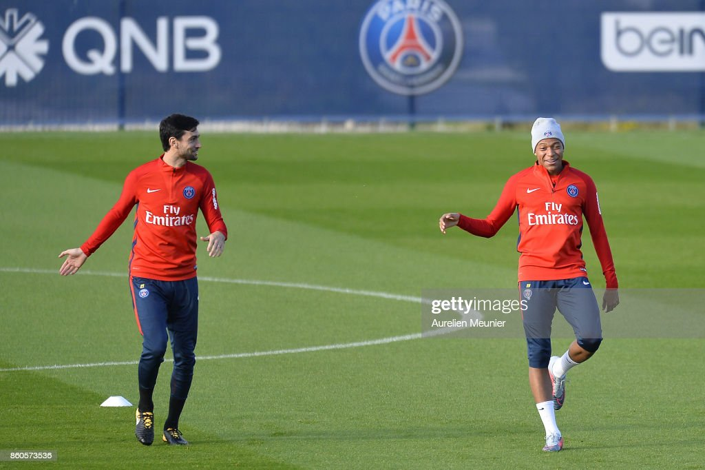 Javier Pastore and Kylian Mbappe of Paris Saint-Germain warm up before a Paris Saint-Germain training session at Centre Ooredoo on October 12, 2017 in Paris, France.