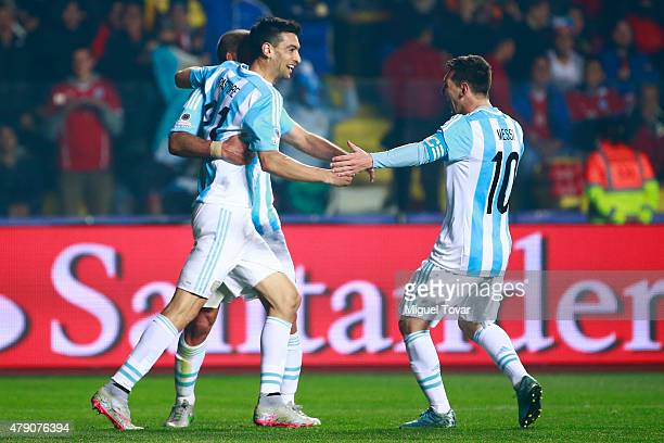 Javier Pastore of Argentina celebrates with teammate Lionel Messi after scoring the second goal of his team during the 2015 Copa America Chile Semi...