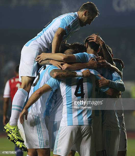 Javier Pastore of Argentina celebrates with teammates after scoring the second goal of his team during the 2015 Copa America Chile Semi Final match...