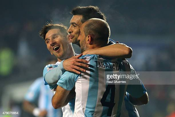 Javier Pastore of Argentina celebrates with teammates Lionel Messi and Pablo Zabaleta after scoring the second goal of his team during the 2015 Copa...
