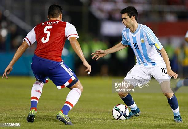 Javier Pastore of Argentina fights for the ball with Bruno Valdez of Paraguay during a match between Paraguay and Argentina as part of FIFA 2018...