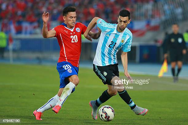 Javier Pastore of Argentina fights for the ball with Charles Aranguiz of Chile during the 2015 Copa America Chile Final match between Chile and...